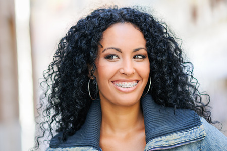 braces: Portrait of young black woman smiling with braces Stock Photo
