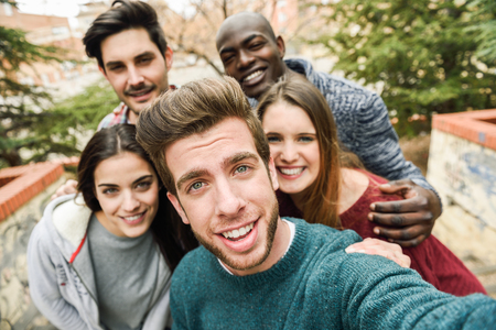 party friends: Multiracial group of friends taking selfie in a urban park Stock Photo