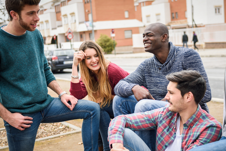 urban people: Group of multi-ethnic young people having fun together outdoors in urban background