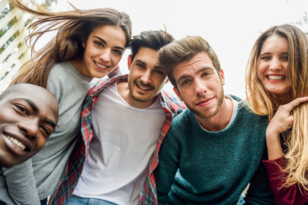 Multiracial group of friends taking selfie in a urban park Banque d'images