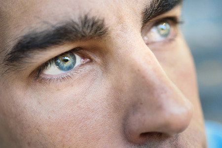 Close-up shot of mans eye. Man with blue eyes. Stock Photo