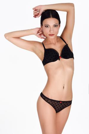 Brunette wearing black thong