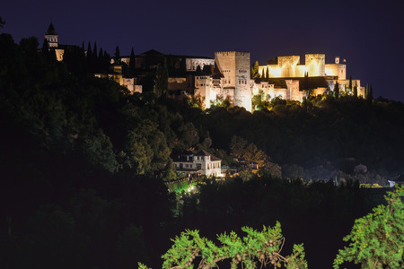 View of the famous Alhambra palace in Granada from Sacromonte quarter, Spain. Night photograph.