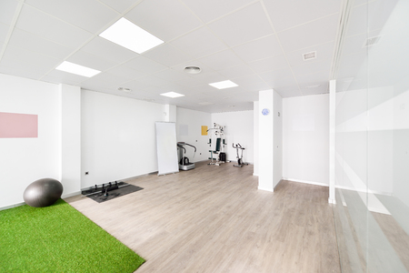 Interior of physiotherapy clinic with equipment for rehabilitation. Physical therapy center.