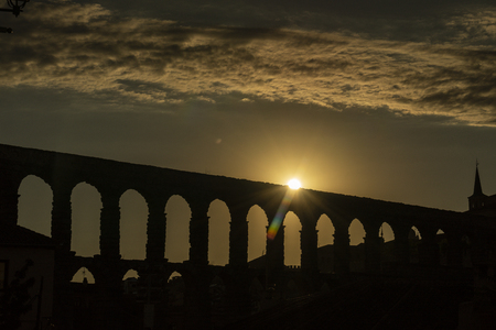 View of the famous Aqueduct of Segovia at Sunset. Roman construction of the 1st century. Travel concept. Spain, Castile and Leon, Segovia.