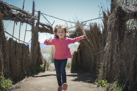 Little girl walking on a path in a wetland in Padul, Granada, Andalusia, Spain