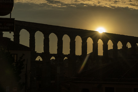 View of the famous Aqueduct of Segovia at Sunset. Roman construction of the 1st century. Travel concept. Spain, Castile and Leon, Segovia. Stock Photo - 109623824