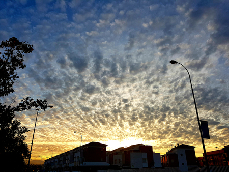 Sunset at city of Granada with beautiful clouds. Urban background