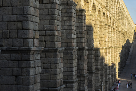 View of the famous Aqueduct of Segovia with beautiful shadow. Roman construction of the 1st century, World Heritage of Unesco. Travel concept. Spain, Castile and Leon, Segovia. Stock Photo - 115350407