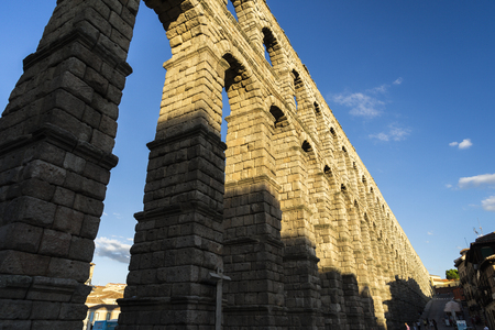 Spain, Castile and Leon, Segovia. View of the famous Aqueduct of Segovia with beautiful shadow. Roman construction of the 1st century, World Heritage of Unesco. Travel concept