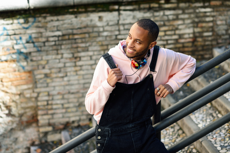 Smiling black man wearing casual clothes outdoors Stock Photo