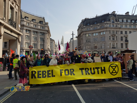 London, United Kingdom, April 15th 2019:- Extinction Rebellion protesters block in Oxford Circus in central London to protest the current environmental emergency