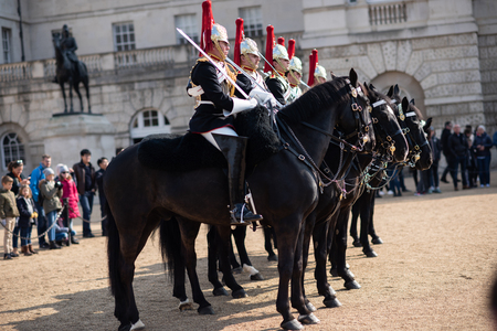 London, United Kingdom - 14th April 2019. Queens Guard March on Horses in the Streets of London, Saint James park