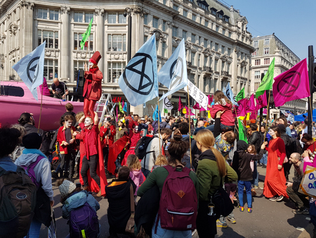 London, United Kingdom, April 15th 2019:- Extinction Rebellion protesters block in Oxford Circus in central London to protest the current environmental emergency Zdjęcie Seryjne - 121979742