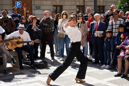 GRANADA, SPAIN 10th MARCH 2019: Flamenco dancer dances for tourists in Plaza Nueva.