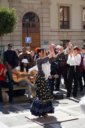 GRANADA, SPAIN 10th MARCH 2019: Flamenco dancer dances for tourists in Plaza Nueva.