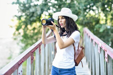 Hiker woman taking photographs with a mirrorless camera 写真素材