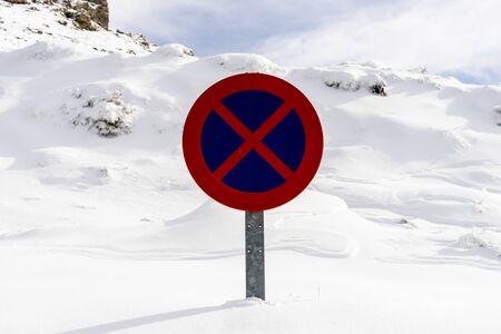 Snowed road sign no parking in Sierra Nevada