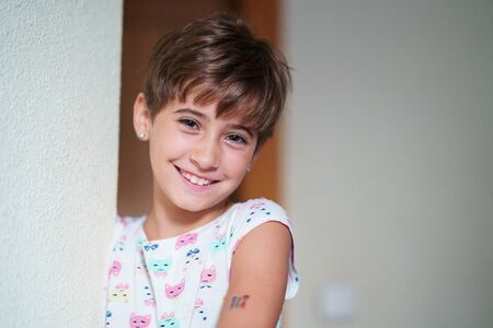 Adorable little girl, eight years old, staring smiling to camera.