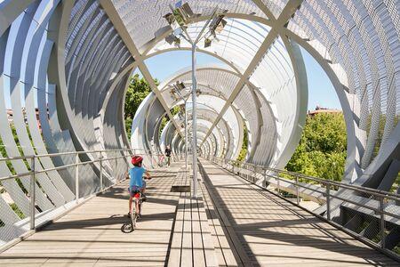 MADRID, SPAIN, 8th August, 2019. Perrault metal spiral Bridge in Rio Madrid.
