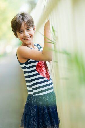 Little girl, eight years old, having fun outdoors.