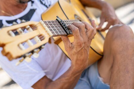 Flamenco musician playing Spanish guitar in Granada..