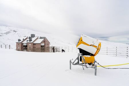 Spain, Andalusia, Granada. Snow cannon in operation at the Sierra Nevada ski resort. Travel and sports concepts.