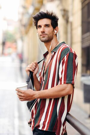 Young male traveler enjoying the streets of Granada, Spain.