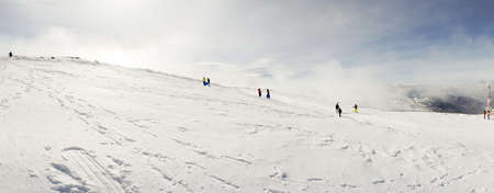 People having fun in snowed mountains in Sierra Nevada