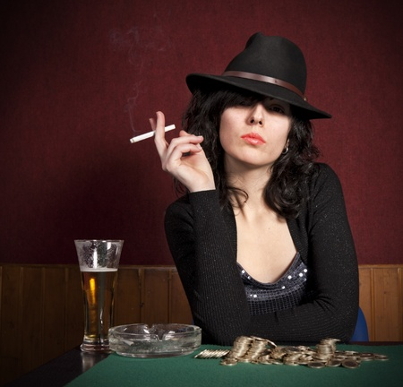 playing with money: Young girl playing poker  Stock Photo