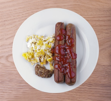 grilled hot dog with ketchup sauce and mustard photo