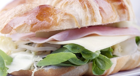 Croissant sandwich with salad ingredients and more photo