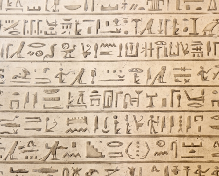 Ancient egyptian hieroglyphics carved in the stone photo