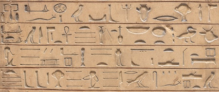 ruins is ancient: Ancient egyptian hieroglyphics carved in the stone Stock Photo