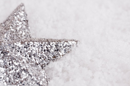 Christmas star on snow background in close up image
