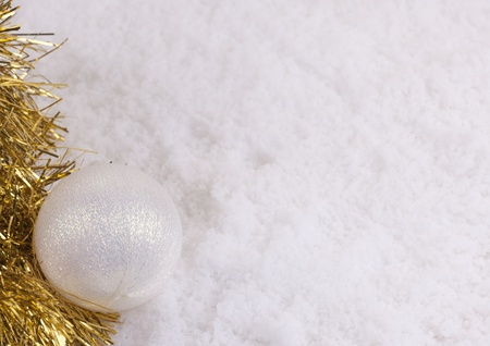 Christmas ball on snow background with copyspace photo