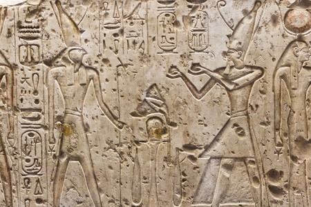 Ancient egyptian hieroglyphics carved in the stone Stock Photo