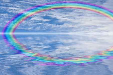 Rainbow in the sky and water reflections