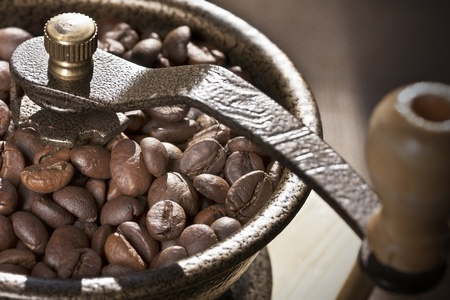 coffee mill and beans in a close up image Stock Photo - 12214744