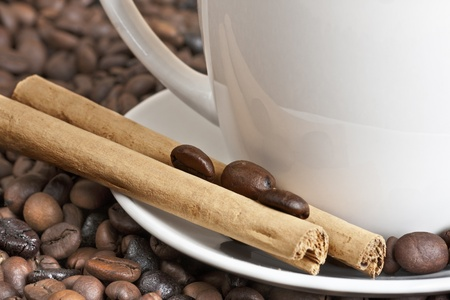 Coffee beans and cinnamon photo