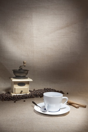 still life image with coffee and mill photo