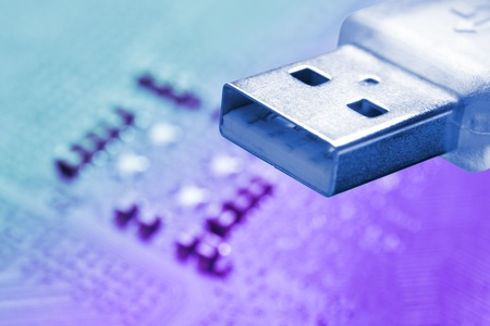 usb memory over a colorful electronic background photo