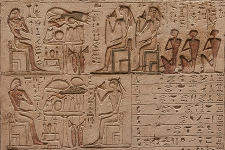 Close up image of an egyptian hieroglyphics carved in the stone