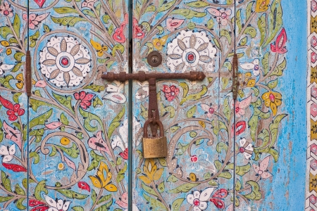 Colorful detail of a locked door photo