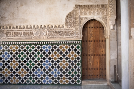 the architecture is ancient: Arab door in the Alhambra in Grandda, Spain Editorial