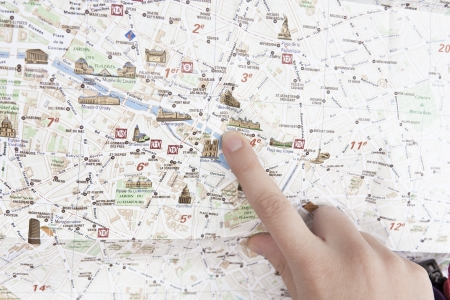 finger pointing at the map of Paris
