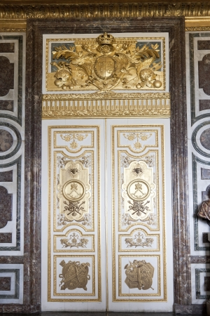 Door in the interior of the Versailles Palace in Paris, France