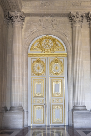 versailles: Door in the interior of the Versailles Palace in Paris, France