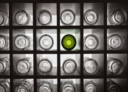 Empty wine bottles on shelves with backlight photo