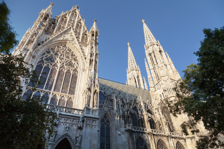 neo gothic: The Votive Church is a neo Gothic church located on the Ringstraße in Vienna, Austria  Stock Photo